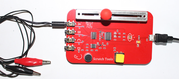 A PicoBoard connected to sensors.